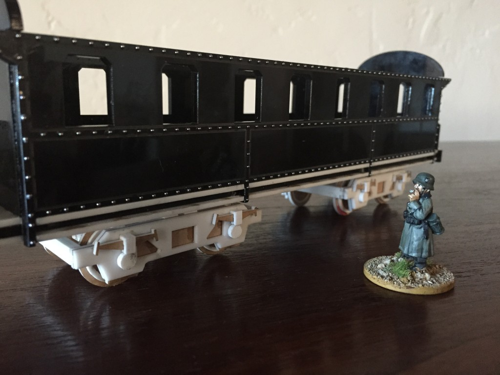 Personenwagon with rivets and trucks.